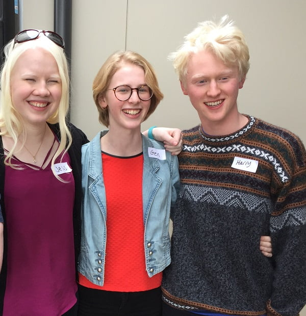 Harry far right with friends at International Albinism Awareness Day event at VisAbility