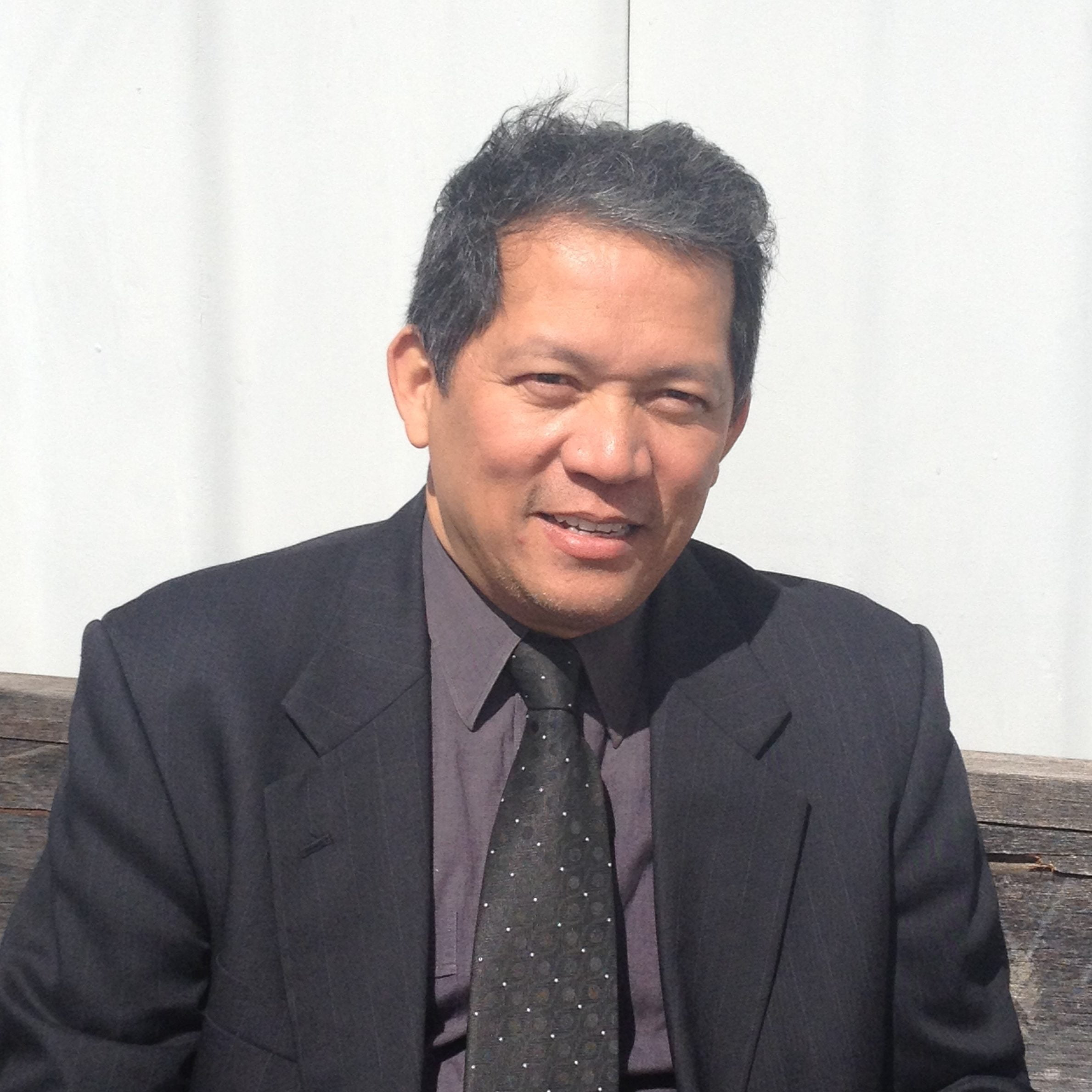 Photo of Kenneth Phua wearing a suit