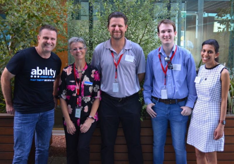 Image of a group of five people at the Perth Web Accessibility Camp at Bankwest. Left-right, David Masters (Microsoft Australia), David (VisAbility), Matt Putland (Centre for Inclusive Design) and Vithya (VisAbility)