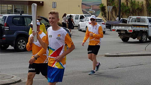 Image of Michael Berg carrying the Baton on the streets in Albany