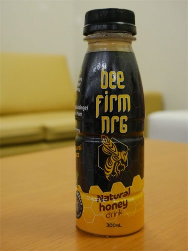 Image of the Bee Firm NRG bottle with the braille packaging