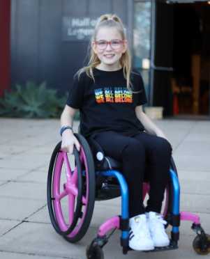 Image shows Emily Prior who is 12 in a wheelchair