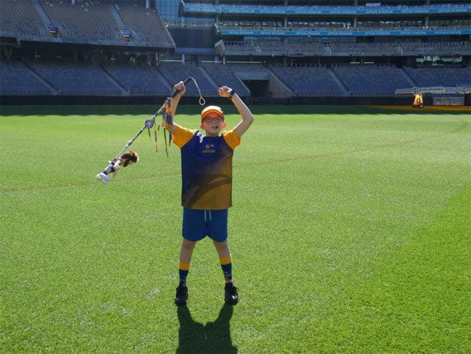 Cooper raises his cane above his dead at the Optus Stadium