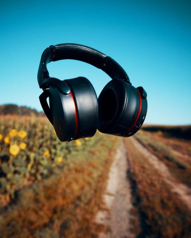 Headphones floating in a field