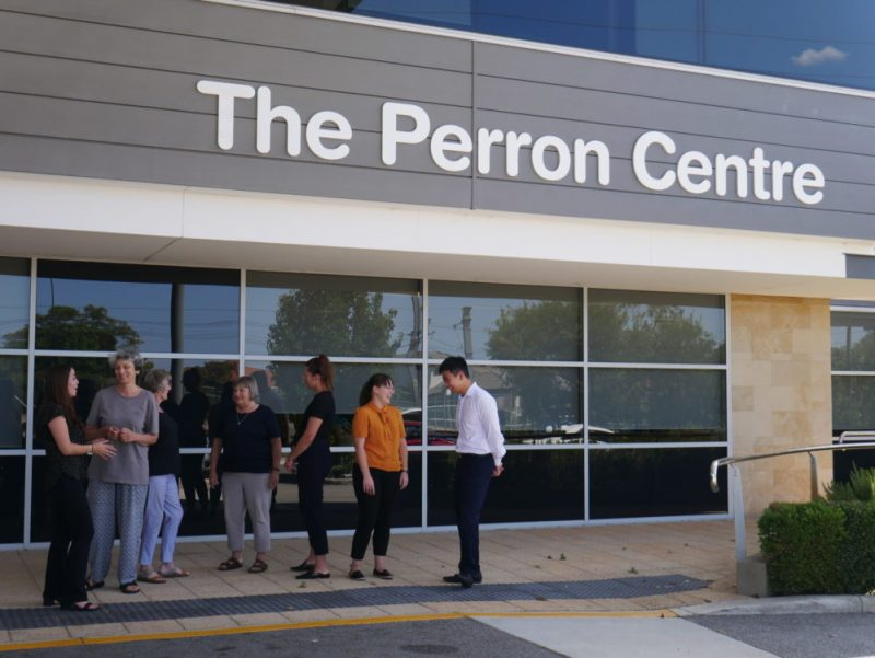 Image of people chatting with each other in front of the Perron Community Centre