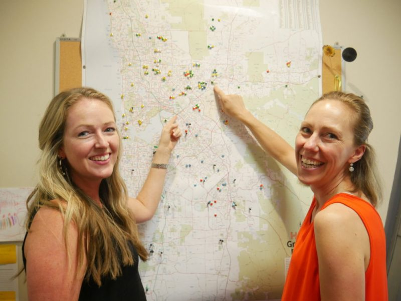 Laura and Annie point to a map which they created to help therapists on the road