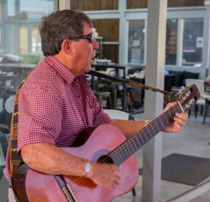 Ron on his guitar singing