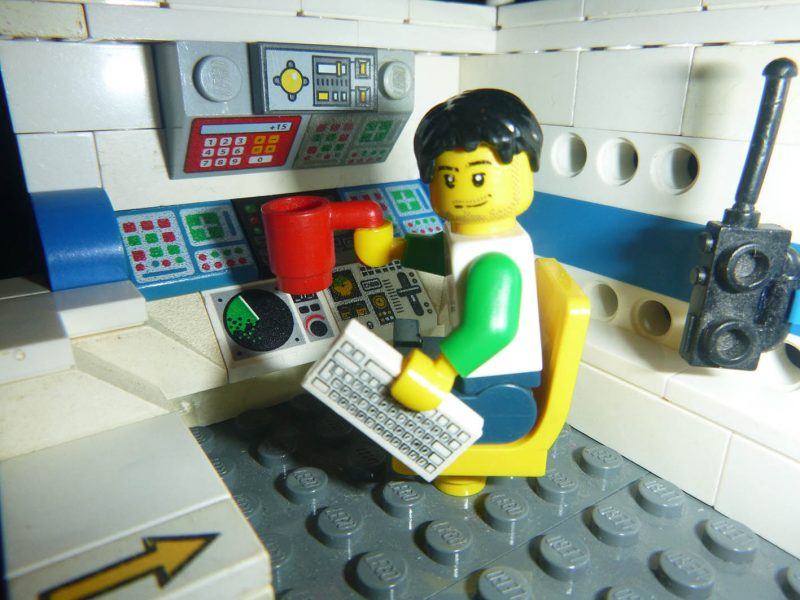 Image of a lego man at his lego work desk
