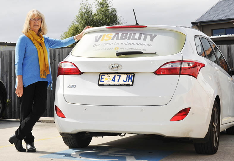 photo of a therapist standing by a car to provide face-to-face therapy services