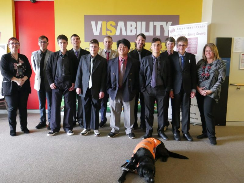 The photograph shows some of the young men on the course, all dressed smartly.