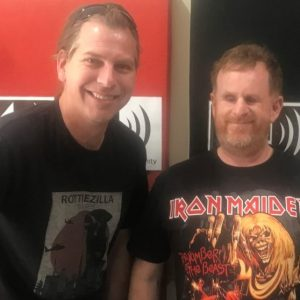 Jeremy harris stands next to Ryan Honschooten at his radio station