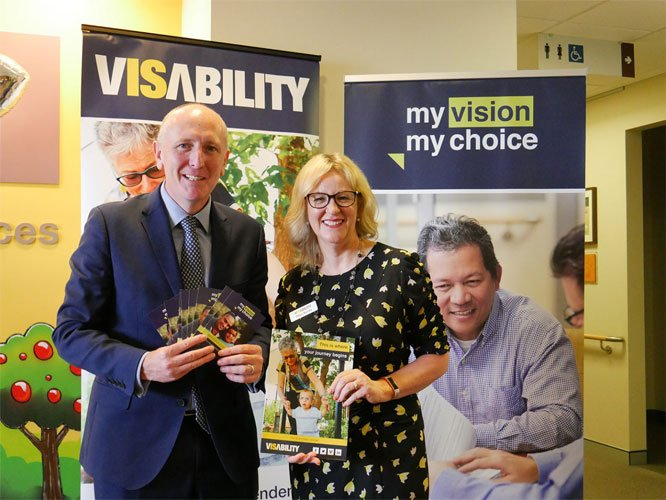 The Honourable Stephen Dawson MLC, Minister for Disability Services and Debra Barnes, Deputy Chief Executive Officer, VisAbility in front of My Vision My Choice banner