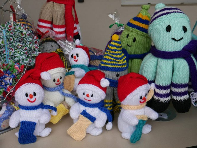Image of handmade, knitted snowmen and octopus, made by the CAC clients like Dorothy