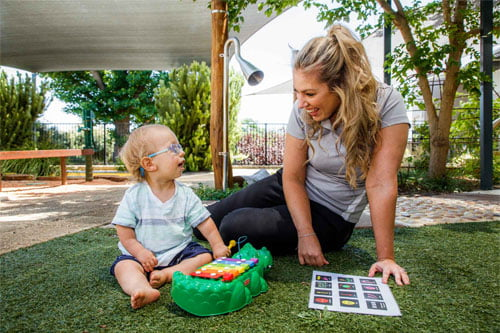 Image of VisAbility therapist with young child