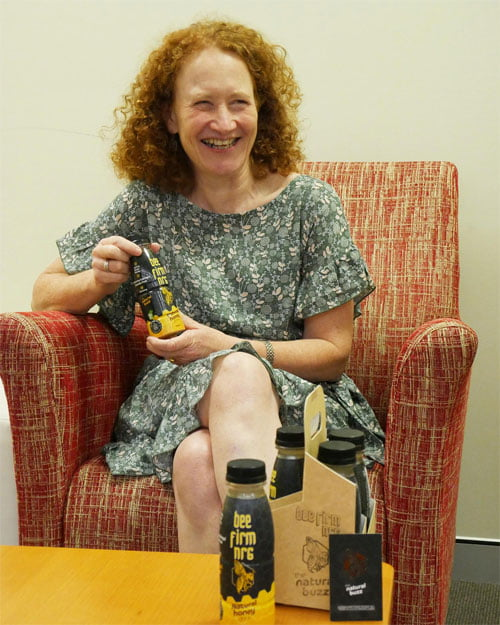 VisAbility team member Leone, with the Bee Firm NRG bottles with braille