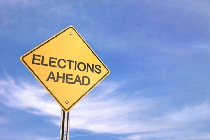 Yellow sign which says Elections Ahead