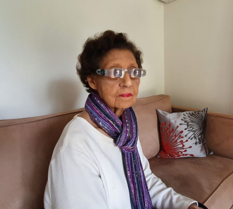 Shirley wears the magnifying glasses for the television