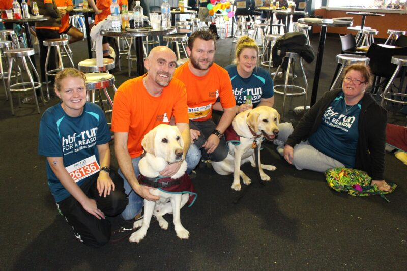 Picture of Jason with his partner Chris when he took part in HBF's run for a reason to raise money for Guide Dogs