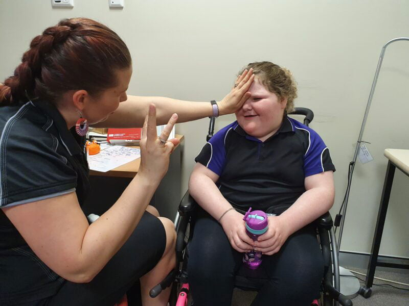 Amy undertakes a vision test with Charlee