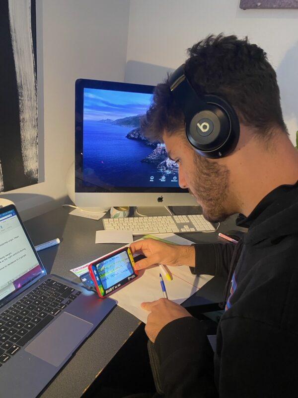Jackson using his video magnifier at his computer
