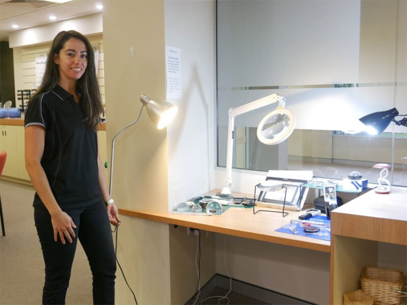 Occupational Therapist Keearny stands by a range of lighting options in the VisAbility shop
