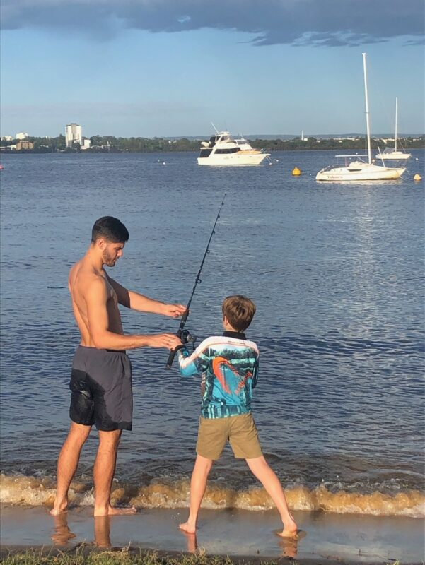 Jackson fishing on teh Swan River with a young lad.
