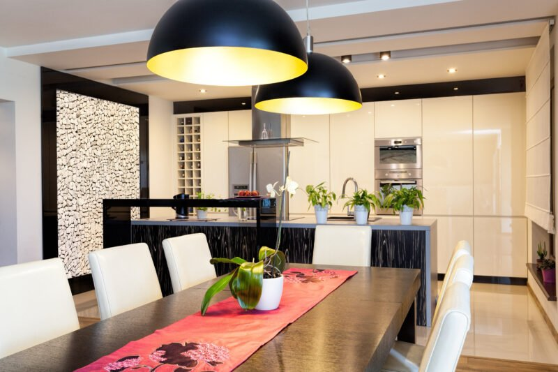 Modern kitchen with plenty of downlighting over dining table