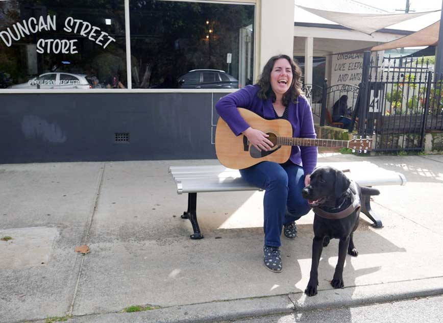 Claire with her black labrador, Guide Dog, Willow