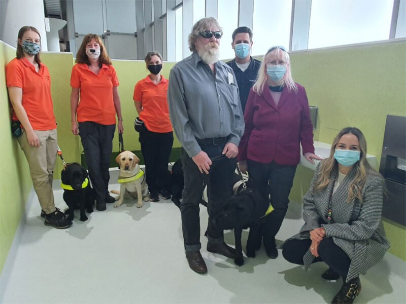 Guide Dogs WA, a Guide Dog Handler Greg Madson with wife Erika and David along with Customer Experience manager Emily O'Connell stand in the new facility