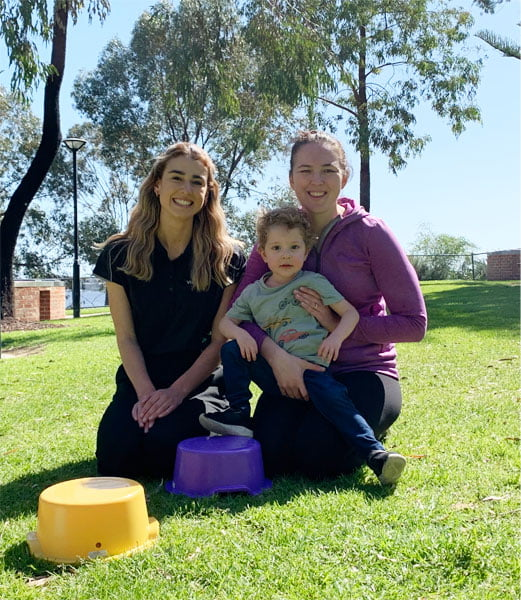 Max, with mum Steph and Physiotherapist, Emma