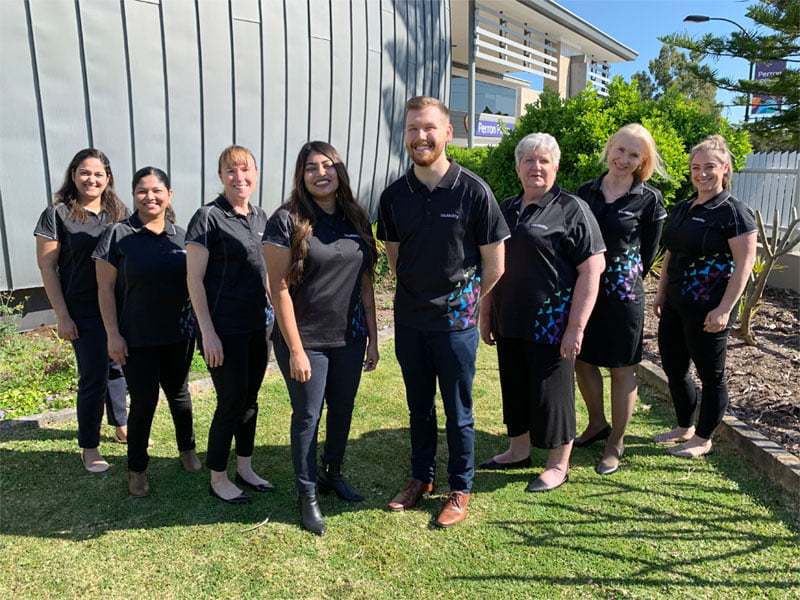 Client Experience Team stand in the Perron Place garden