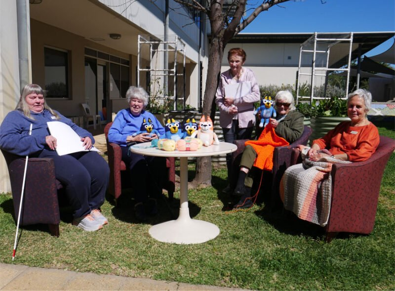 Our Braille crochet and knitters sit in teh garden
